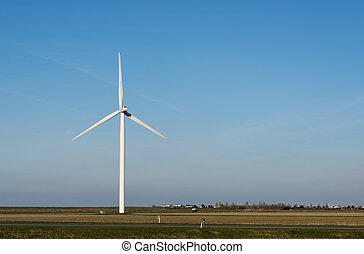 single windmill in dutch landscape