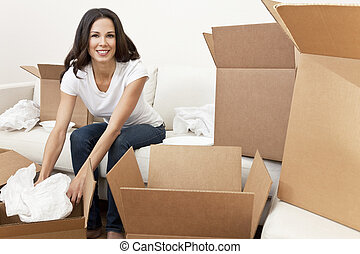 Single Woman Unpacking Boxes Moving House - A beautiful ...
