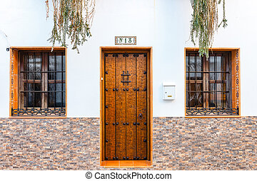 single wooden door with number thirteen on a wall