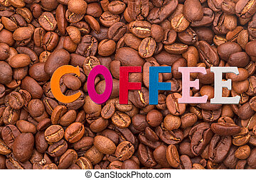 Single word - coffee - Background from coffee beans and...
