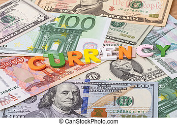 Single word - currency - Background from banknotes of...