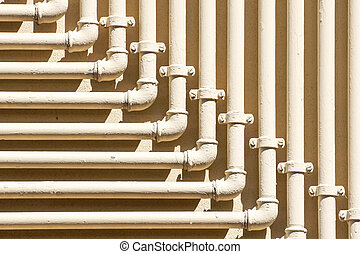 Single yellow gas, oil and water pipeline on gray or black wall