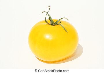 Single yellow tomato on w