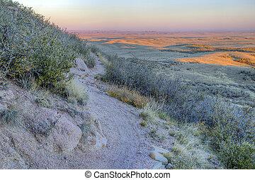 singletrack bike trail and prairie