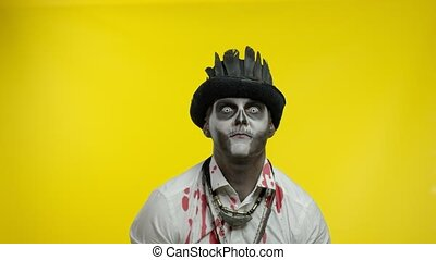 Sinister man with professional Halloween skeleton makeup ...