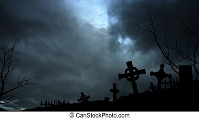Sinister view - night cemetery, stormy sky and lightning....