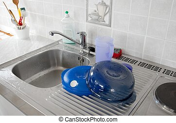 Sink for washing dishes in a kitchen
