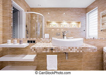 Sink in beige bathroom - Sink in beige marble bathroom with...