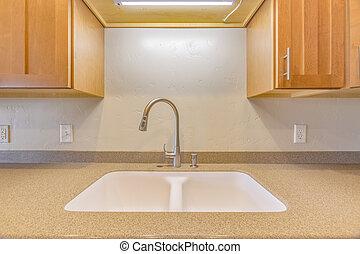 Sink in clean kitchen