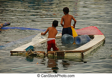Sinking Boat - Two boys baling out sinking dinghy