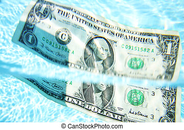 Sinking Dollar - Dollar bill sinking into blue water