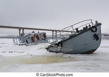 Sinking vessel in a frozen river