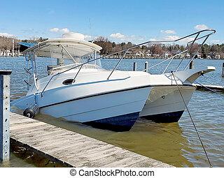 sinking white catamaran in marina - sinking white catamaran ...