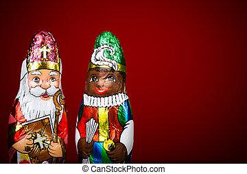Sinterklaas and Zwarte Piet. Dutch chocolate figurine -...