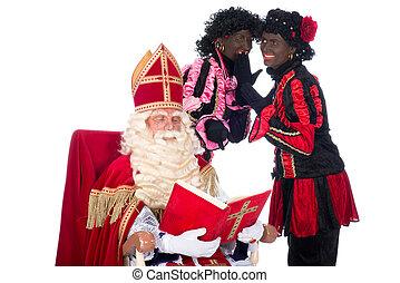 Sinterklaas and Zwarte Piet - Sinterklaas is reading in his...