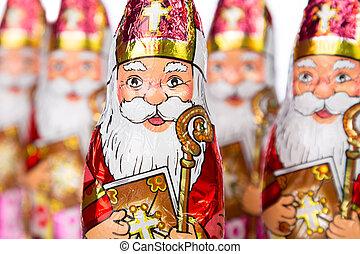 Close up of Sinterklaas. Saint Nicholas chocolate figure of Dutch character of Santa Claus.
