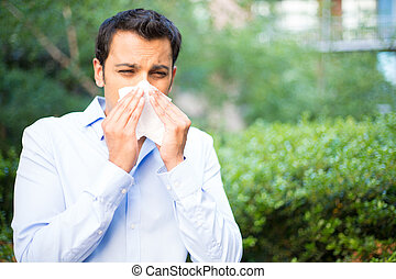 Sinus problems - Closeup portrait of young man in blue shirt...