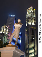 Sir Stamford Raffles statue at night, Singapore - Tourism...