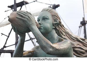 siren as figurehead of an old sailboat