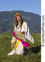Sirena Sabiha dancing with a fan at sunrise in Pokhara, Nepal. Sirena was born in the Philippines.
