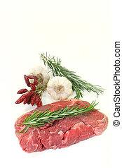 Sirloin steak - a piece of raw sirloin steak with rosemary ...