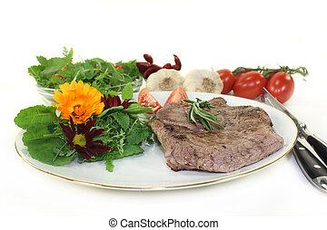 Sirloin steak - a roasted ribeye steak with wild herb salad