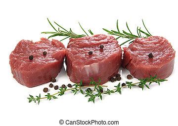 Sirloin steak - Raw sirloin steak with pepper on a white ...