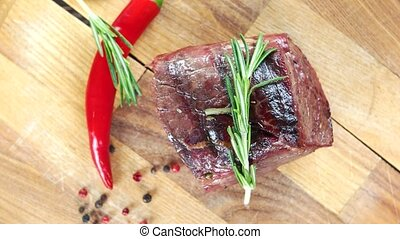 Sirloin steak with rosemary. Barbecue beef top view.