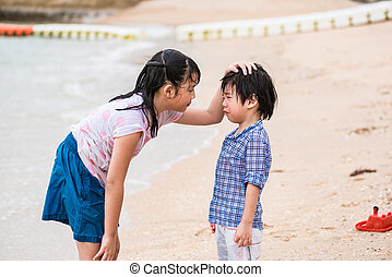 Sister and brother - Close up of cute asian sister try to...