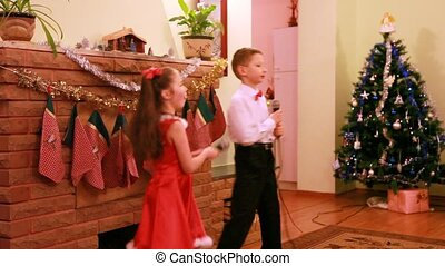 Sister and brother dance and sing song into microphone
