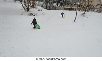 sister and brother rushing with sno