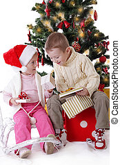 Sister and brother showing Christmas presents