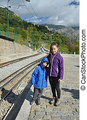 Sister and brother waiting for the train