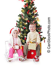 Sister and brother with Christmas presents