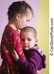 Sister consoles brother