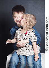 Sister Kissing Brother. Small Girl and Boy