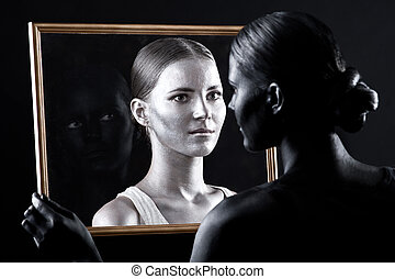sister looks at her twin through the glass