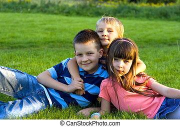 sister with brothers - Sister with brothers on a meadow