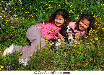 sisters and dog