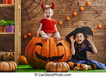 sisters celebrate Halloween - Two cute funny sisters...