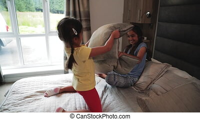 Sisters Having a Pillow Fight - Slow motion of sisters...