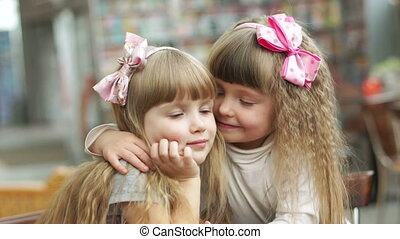 Sisters hugging and kissed
