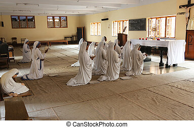 Sisters of Mother Teresa's Missionaries of Charity in prayer in the chapel of the Mother House, Kolkata