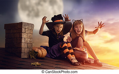 sisters on Halloween - Two happy sisters on Halloween. Funny...
