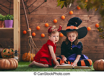 sisters on Halloween - Two cute funny sisters celebrate the...