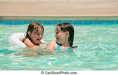 Sisters Playing in a Pool Outdoors