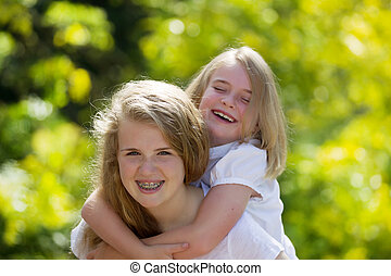 Sisters sharing a laugh together