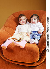 Sisters sitting in chair