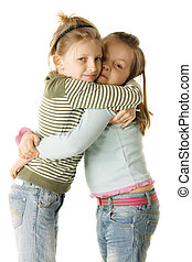 Sisters - Two little sisters standing in hug photo over...
