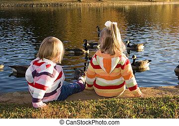 Sisters watching the ducks